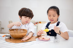 Asian Chinese little brother and sister preparing to bake cookie Stock Image