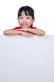 Asian Chinese little girl behind a blank white board Royalty Free Stock Photos