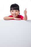 Asian Chinese little girl behind a blank white board Stock Images