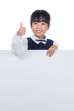 Asian Chinese little girl behind a blank white board Stock Photo