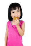 Asian Chinese little girl biting gold medal Royalty Free Stock Image