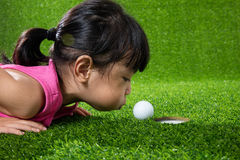 Free Asian Chinese Little Girl Blowing The Ball Into A Hole Stock Image - 95179991