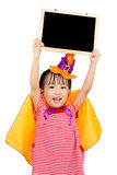 Asian Chinese Little girl celebrate Halloween. Asian Chinese Little girl celebrate Halloween holding blank black board Royalty Free Stock Photography