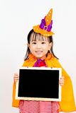 Asian Chinese Little girl celebrate Halloween. Asian Chinese Little girl celebrate Halloween holding blank black board Stock Photos