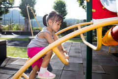 Asian Chinese little girl climbing stepladder Stock Photography