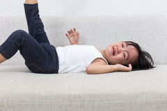Asian Chinese little girl crying on the sofa Royalty Free Stock Image