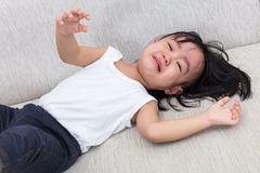 Asian Chinese little girl crying on the sofa Royalty Free Stock Photo