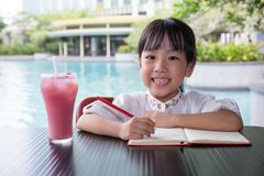 Asian Chinese little girl doing homework Royalty Free Stock Photo