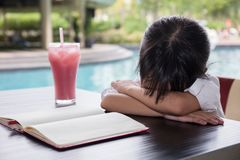 Asian Chinese little girl doing homework Stock Photos