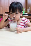 Asian Chinese little girl drinking beverage Royalty Free Stock Images