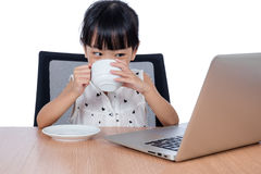 Asian Chinese little girl drinking coffee Royalty Free Stock Image
