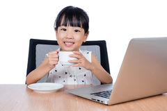 Asian Chinese little girl drinking coffee Royalty Free Stock Images