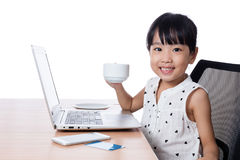 Asian Chinese little girl drinking coffee Royalty Free Stock Photography