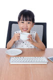 Asian Chinese little girl drinking coffee Stock Images