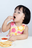Asian Chinese little girl Eating French fries Stock Images