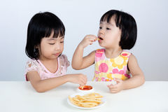 Asian Chinese little girl Eating French fries Royalty Free Stock Photography