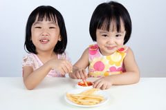Asian Chinese little girl Eating French fries Royalty Free Stock Images