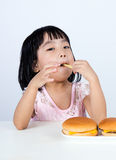 Asian Chinese little girl Eating French fries Stock Photos