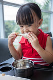 Asian Chinese little girl eating fried chicken Stock Images