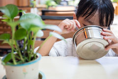 Asian Chinese little girl eating fried rice Stock Photos