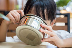 Asian Chinese little girl eating fried rice Royalty Free Stock Photography
