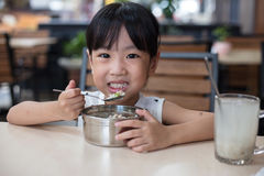 Asian Chinese little girl eating steamed minced pork and rice Royalty Free Stock Photos