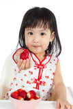 Asian Chinese little girl eating strawberries Royalty Free Stock Image