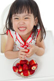Asian Chinese little girl eating strawberries Stock Photo