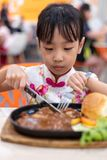 Asian Chinese little girl eating Western Food royalty free stock photos