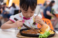 Asian Chinese little girl eating Western Food royalty free stock photo