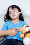 Asian Chinese little girl examine by doctor with stethoscope. In the hospital Royalty Free Stock Photo