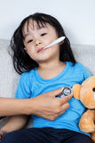 Asian Chinese little girl examine by doctor with stethoscope. In the hospital Stock Image