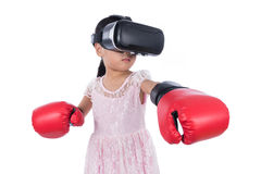 Asian Chinese little girl experiencing virtual reality with boxi Stock Photo