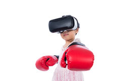 Asian Chinese little girl experiencing virtual reality with boxi Stock Photos