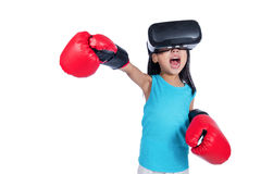 Asian Chinese little girl experiencing virtual reality with boxi. Ng gloves in isolated white background Stock Photos
