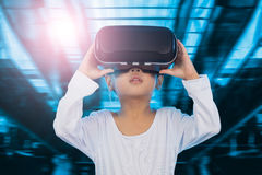 Asian Chinese little girl experiencing virtual reality eyeglasss Royalty Free Stock Image