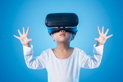 Asian Chinese little girl experiencing virtual reality eyeglassses stock photo