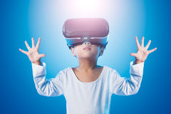 Asian Chinese little girl experiencing virtual reality eyeglasss Stock Image