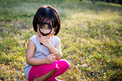 Asian Chinese Little Girl Exploring With Magnifying Glass Stock Image