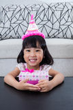 Asian Chinese little girl with gift box celebrating birthday Stock Image