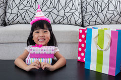 Asian Chinese little girl with gift box celebrating birthday Stock Images