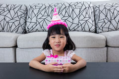 Asian Chinese little girl with gift box celebrating birthday Stock Photos