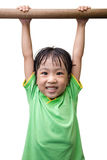 Asian Chinese little girl hanging on horizontal bar. In isolated white background Stock Image