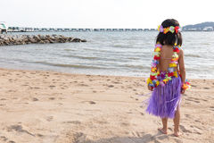 Asian Chinese little girl in hawaiian costume Looks Far Away Royalty Free Stock Photo