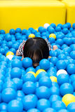 Asian Chinese Little Girl Hiding At Balls Pool Stock Photos