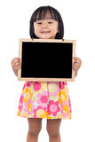 Asian Chinese little girl holding blank blackboard Stock Photo