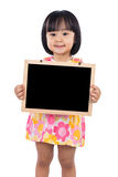Asian Chinese little girl holding blank blackboard Stock Images