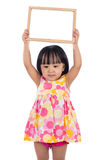 Asian Chinese little girl holding blank whiteboard Royalty Free Stock Images
