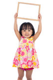 Asian Chinese little girl holding blank whiteboard Royalty Free Stock Photography