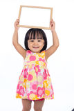 Asian Chinese little girl holding blank whiteboard. In isolated white background Royalty Free Stock Photography